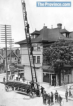 Archival photo from the city of #Vancouver's archives: The city's first horse-drawn aerial ladder, northwest corner of Seymour and Robson Streets in 1911.