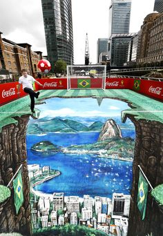 Coca Cola - Canary Wharf was taken over recently by a giant, interactive football-inspired 3D artwork set up. The pop-up visual experience was unveiled by former England international Michael Owen launching Coca Cola's new Win A Ball promotion ahead of the World Cup. Designed to transport fans straight from the River Thames to Rio de Janeiro's iconic cityscape, the promotion also serves a charitable cause by benefiting Coca Cola UK's charity partner, StreetGames.