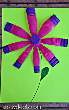 Have your kids make this pretty water bottle flower craft for Spring!