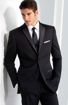 Black tux with burgundy tie by Freeman | Down the Aisle ...