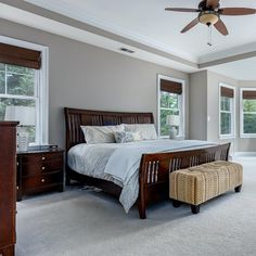Executive owner's suite with a sitting room, carpet, dual walk-in closets, neutral paint, ceiling fan and spa-like en suite bathroom. Listed in Vienna Virginia by The Casey Samson Team is a Wall Street Journal Top Team in Northern Virginia.