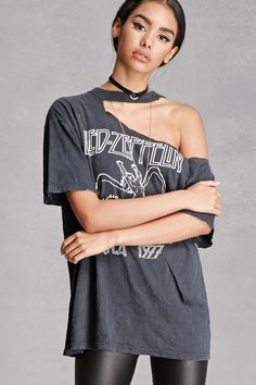 """A vintage oversized band tee featuring a Led Zeppelin """"United States of America 1977"""" graphic, frayed rips at the crew neck and front, and short sleeves. Each vintage item is one-of-a-kind and has a unique wash and fit."""