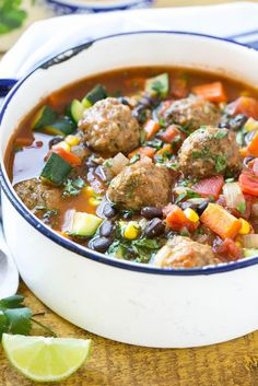 This recipe for mexican meatball soup is loaded with seasoned beef meatballs, black beans and plenty of vegetables in a flavorful and spicy broth. Add your favorite toppings and you've got a complete meal in a bowl! Slow Cooker Tortellini Soup, Italian Sausage Tortellini Soup, Slow Cooker Creamy Chicken, Slow Cooker Soup, Mexican Meatball Soup, Mexican Meatballs, Meatball Recipes, Chicken Meatball Soup, Meatball Bake