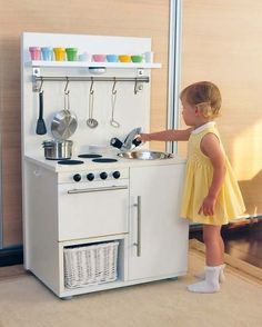 Wonderful Toy Kitchen made by Emese &Tamas in Hungary with parts and pieces repurposed and gathered from bargain bins.