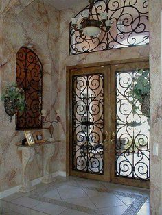 Wrought Iron Door from Faux Iron Design Our new front door and service door designed by them to have lions. Wrought Iron Doors, Tuscan House, Tuscan Decorating, Entrance Doors, Door Design, Windows And Doors, Sidelight Windows, New Homes, Interior Design