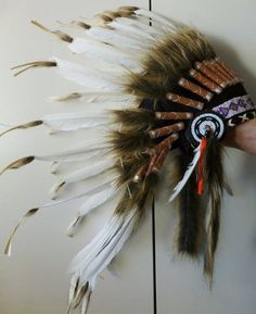 For Children: Indian All White Feather Headdress For Children: Indian all White Feather Headdress. Fun and Original Costume for children, long rooster white feathers all around.. Is a hat, whith an adjustable elastic band on the back.. From 5 to 14 years old. Head Circumference: 21 inch.. Let your kid be and Indian and make the greatest photoshoot ever!.  #The_World_of_Feathers #Apparel