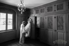 The bride in her silk robe with her Yaki Ravid wedding gown at Villa Terrace in Milwaukee, by Front Room Photography