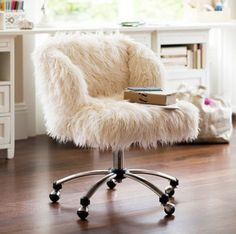 The fluffy chair. I need it!