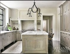 Our perfect.  Washed grey oak cabinets, white granite counters, dark floors.