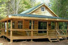 Cabins And Cottages: Wraparound Cabin - Possibility. dont care for the round poles and want metal roof. Tiny Cabins, Tiny House Cabin, Log Cabin Homes, Cabins And Cottages, Log Cabins, Country Cottages, Cabin House Plans, Mountain Cabins, Cabin Kits