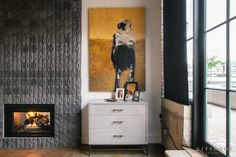 double sided fireplace, tile, painting, art, large windows, concrete floor, white walls, Andrea Beecher, cityhomeCOLLECTIVE