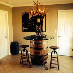 Jack Daniel's Whiskey Barrel as kitchen table with glass top