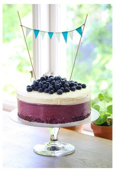 Blueberries on top of cake and bunting