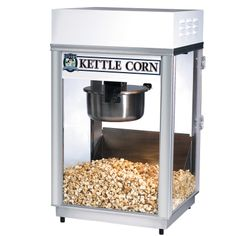 #2660KC - Kettle Corn Popper: Pappy`s Deluxe 60 Special by Gold Medal Products Co. This is the show piece of all 6 oz. deluxe machines and features antique styling. Etched glass, cast filigree, brass-like antique finish. Features: - Right hand kettle is for salted popcorn. - Left hand kettle is for sweet popcorn