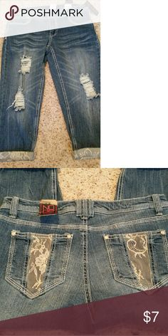 Brand new jean capris Distressed cropped jeans with lace detail on bottom and back pockets. Nwt nobo Jeans