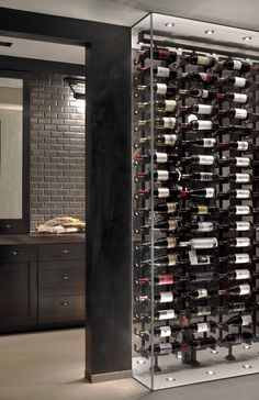 Wine cabinet between Dining and Butler Pantry by Charles Vincent George Architects, Inc.