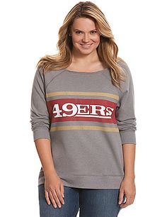 Cheer on your San Francisco 49ers in soft, fleece comfort in this stylish graphic sweatshirt. Vintage-inspired faded graphic and a rough-edged wide neckline that can be worn off the shoulder make this one a game-changer, with long sleeves to keep you cozy from sports bar to stadium and beyond. lanebryant.com