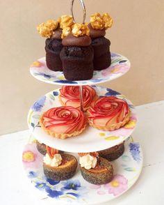 treeeeeeats! on new @bluebellgray cake stand  top to bottom: chocolate salted caramel popcorn rose apple custard tarts & black sesame coconut & blood orange friand
