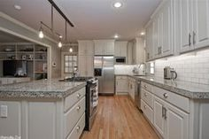 Traditional Kitchen with Raised panel, flush light, Santa Cecelia Granite Countertop, White Subway Tile 3x6 Glossy, L-shaped