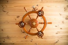 Wooden ceiling chandelier in the children's room in a nautical style as a ship's wheel, 3 lights with ship Nautical Chandelier, Wooden Chandelier, Chandelier Ceiling Lights, Nautical Style, Nautical Fashion, Ship Wheel, Wooden Ceilings, Lighting Solutions, The Help