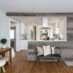 Who says white kitchens have to be dull? Add a splash of flavor with reclaimed wood. 🏡Link To More Farmhouse-Inspired White Kitchen Ideas In Bio🏡 Design: Photo: Half Wall Kitchen, Open Kitchen And Living Room, Kitchen Room Design, Modern Kitchen Design, Kitchen Interior, Home And Living, Kitchen Ideas, Kitchen Pass, Barn Kitchen