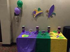 Mardi Gras Candy Station with masks over candy dishes