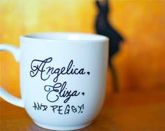 Hamilton Schuyler Sisters Hand-Painted Mug by abirdinthehand Hamilton Schuyler Sisters, Hamilton Gifts, Aaron Burr, And Peggy, Lin Manuel Miranda, Fandoms, The Incredibles, Hand Painted, Mugs