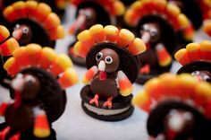 Thanksgiving: these little turkeys took some work but they were so cute!! I used double stuffed Oreos to fit the candy corns down in. I also used chocolate squeeze frosting as glue for the Oreos and what not.