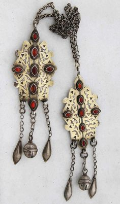 Central Asia | Beautiful rare isirgalik Turkman set, signed and dated on rear in Arabic 1224 which makes it, in 2011, 174 years old but this is questioned by experts, and the piece may be younger (20th century). Signed by Aga Jan on rear of both pendants. |  Solid silver, gold wash, original carnelian cabochons. | Used to be worn over head, nowadays worn over shoulders | ©Savanna Caravan, via Ethnic Jewels