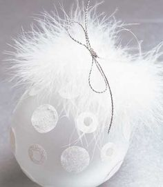 White feathers turn an ornament into a soft and stunning decoration.