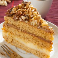 This caramel layer cake recipe gives you 3 delicious cake layers sandwiched with a creamy pudding and brown sugar frosting, topped with crunch walnuts.