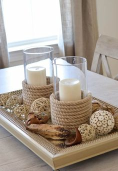 "See how I made my own sisal candle holders and used these from HomeGoods as my inspiration. Wrapping sisal around a glass candle holder is a great way to ""get the look"" on a budget. What a great coastal centerpiece! Beach House Decor, Diy Home Decor, Room Decor, Decor Crafts, Diy Crafts, Deco Marine, Diy Candle Holders, Nautical Candle Holders, Nautical Candles"