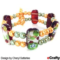 DIY Gold Foil & Glass Pearls Memory Wire bracelet sure to garner admirers! Supplies and DIY from eCrafty.com #memorywire #diy #crafts #beads #beading #gold #green #diybracelet #memorywirebracelet #pearls #glasspearls #dragonfly #ecrafty