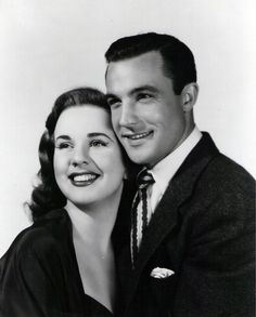 Gene Kelly as Hank Mullen and Deanna Durbin as Bess Macintosh.