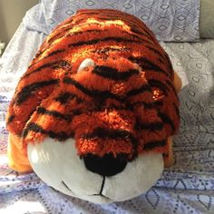Tiger pillow pet Barely used pillow pet! No stains, can't even tell it was used at all! Fluffy and in great condition Pillow Pet Other