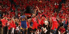 Golden State Warriors' Steph Curry hits the game tying 3 over the New Orleans Pelicans in game 3 of the first round in the 2015 NBA Playoffs