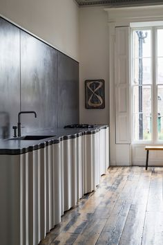 Architect Jake Moulson has renovated a dilapidated Dublin house, Townhouse, creating a dramatic set of interiors filled with bespoke furniture. Cladding Systems, Cladding Panels, Kitchen Interior, Kitchen Design, Kitchen Decor, Decorating Kitchen, Kitchen Ideas, Decorating Ideas, Modular Furniture