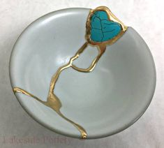 Kintsugi bowl with heart shaped gem stone