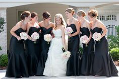This was me at my wedding! I loved our theme of black, white and blush.  My dress was Lazaro 3100 and bridesmaids dresses were also by Lazaro. Tweet me @_NicoleEmerick with questions.
