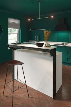 This raised breakfast bar doubles up as a surface for serving drinks and entertaining guests, with the white finish breaking up the bold colour of the kitchen. Industrial Kitchen Island, Kitchen Island With Seating, Wooden Kitchen, Green Kitchen, Kitchen Colors, Kitchen Design, Kitchen Ideas, Designer Bar Stools, Shaker Style Kitchens