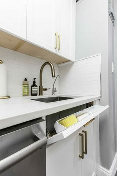 A Galley Kitchen Gets in Line A custom drawers hold sponges, keeping the countertop clear and uncluttered. A Galley Kitchen Gets in Line A custom drawers hold sponges, keeping the countertop clear and uncluttered. Smart Kitchen, Ikea Galley Kitchen, White Galley Kitchens, Galley Kitchen Design, Galley Kitchen Remodel, Kitchen Room Design, Kitchen On A Budget, Modern Kitchen Design, Kitchen Interior