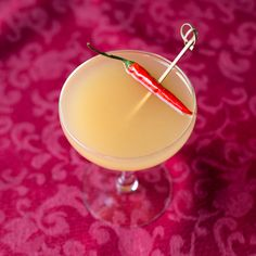 Eros Elixir FOR THE COCKTAIL: 2 oz. white whiskey 1 oz. spiced pear syrup ¾ oz. freshly squeezed lime juice ½ oz. ginger liqueur ½ oz. Thai chile-infuse...