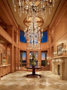 This luxurious entry hall was completed by Toth Construction. #luxePNW
