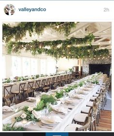 Roche Harbor Wedding. I love the green garlands and bistro light hanging from the ceiling beams.