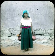 | Mujer zapoteca | c. 1900.  Hand-painted lantern slide. SEAA Mexican Lantern Slide Collection, Image Archive.