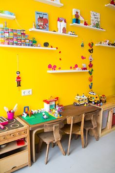 The kid's room is filled with toys: Lego, Playmobil, a pretend kitchen, cars and a lot of ponies!