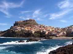 Castelsardo | Located in Sardinia, Italy, this medieval town of 5,000+ residents features colorful buildings overlooking a beautiful view of the Mediterranean Sea.