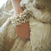 Gather up Amsale bridal gowns and pearl bracelets. Such a flattering color.