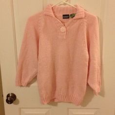 Pink Sweater Pink sweater with quarter length sleeves. It has a big pink button in front. Gotham Sweaters