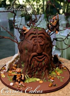 Is your guy a huge Lord Of The Rings fan? This Treebeard cake by Carrie's Cakes in a fun way to highlight the groom's favorite book and movie series! | Groom's Cake Ideas
